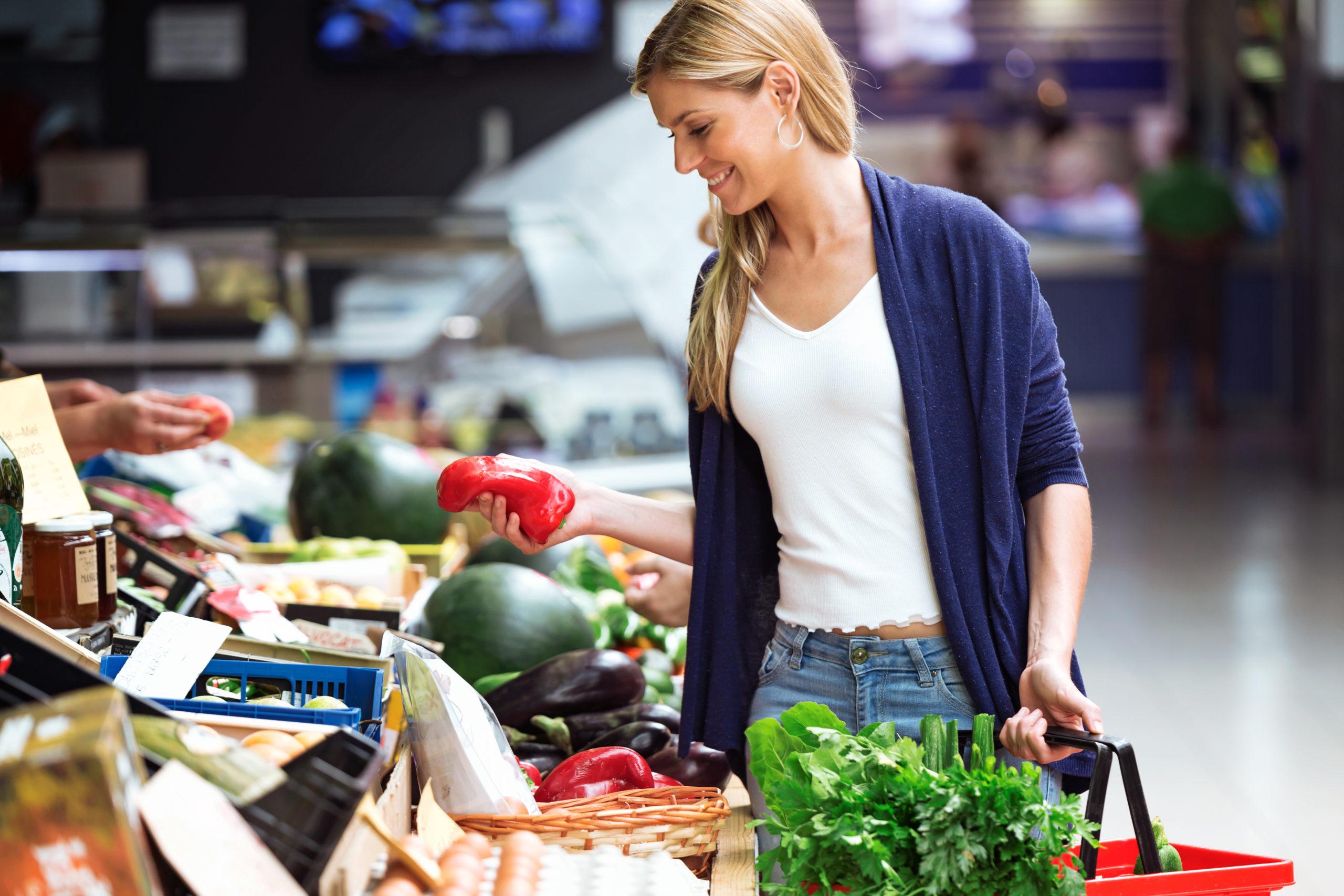 woman buying veggies